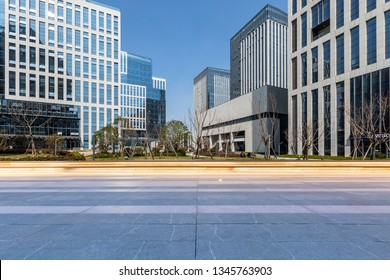 Panoramic skyline and modern business office buildings with empty road,empty concrete square floor