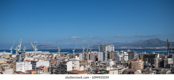 Panoramic skyline of Palermo, Sicily, Italy with cranes at the international commercial port