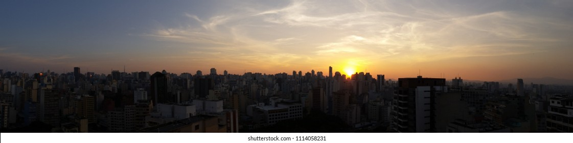 Panoramic skyline view of central and west side Sao Paulo megalopolis, Brazil, during sunset. May 09, 2015.