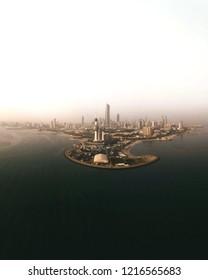 Panoramic skyline view of kuwait city at sunrise