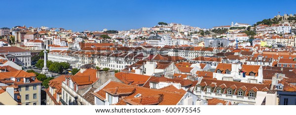 Panoramic skyline view of Lisbon old town, Portugal. Rossio Square and Pombaline downtown of Lisbon (Lisbon Baixa) on the background