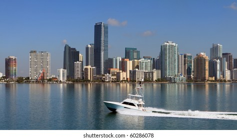 Panoramic Skyline view of Miami and Biscayne Bay from the Key Biscayne Bridge with fishing yacht cruising by.