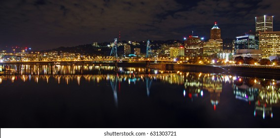 Panoramic skyline view with the steel bridge of Portland, Oregon at night