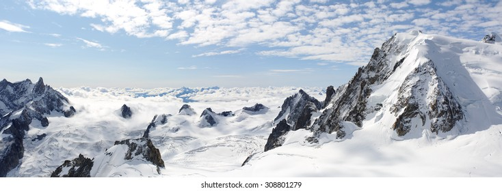Panoramic snowy high mountains climb landscape with cloudy sky