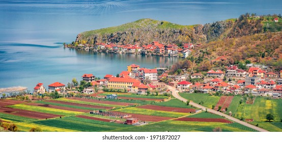 Panoramic spring cityscape of Lin town. Sunny morning scene of Ohrid lake. Picturesque outdoor scene of Albania, Europe. Traveling concept background.