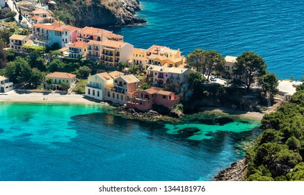 Panoramic spring seascape of Ionian Sea. Wonderful Sunny Day. Beautiful view over the sea beach in Assos village with colorful houses. Kefalonia island. Greece