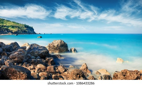 Panoramic spring view of Avali Beach. Breathtaking morning seascape of Ionian sea. Exciting outdoor scene of Lefkada Island, Greece, Europe. Beauty of nature concept background.