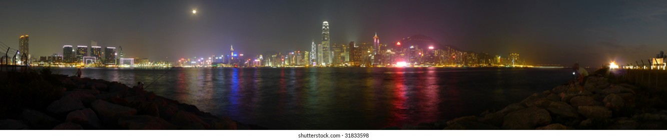 Panoramic Stitch: Victoria Harbor Of Hong Kong China In A Stormy Evening