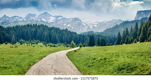 Panoramic summer scene of Durmitor Nacionalni Park. Picturesque foggy view of of Montenegro countryside, Zabljak town location. Beautiful world of Mediterranean countries. Traveling concept background