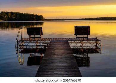 Panoramic summer sunset view of Jezioro Selmet Wielki lake landscape with recreation pier in Sedki village in Masuria region of Poland - Shutterstock ID 2014766270