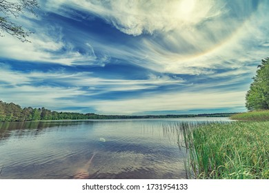 Panoramic summer view of common lake and skyline among forest in Russia