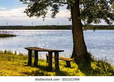 Panoramic summer view of Jezioro Selmet Wielki lake landscape with camping pier and wooded island in Sedki village in Masuria region of Poland - Shutterstock ID 2011511984