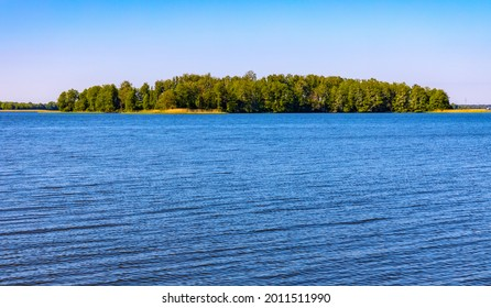 Panoramic summer view of Jezioro Selmet Wielki lake landscape with wooded island in Sedki village in Masuria region of Poland - Shutterstock ID 2011511990