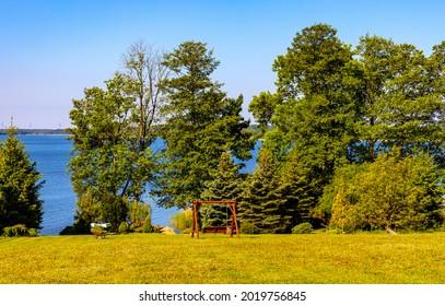 Panoramic summer view of Jezioro Selmet Wielki lake landscape with wooded shoreline in Sedki village in Masuria region of Poland