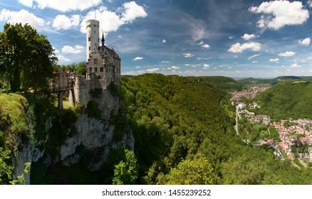 Panoramic summer view of Lichtenstein Castle (Schloss Lichtenstein) and valley of Echaz river. Baden-Wuerttemberg. Germany.