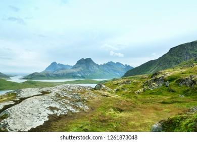 Panoramic summer view of Lofoten Islands on the way to Ryten mountain. Lofoten islands, Norway