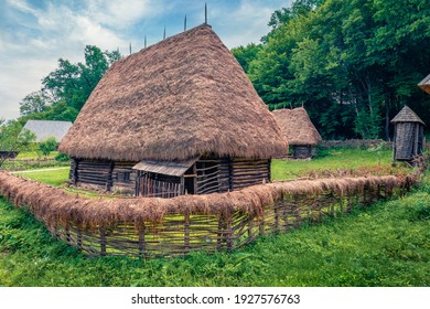 Panoramic summer view of traditional romanian peasant houses. Stunning rural scene of Transylvania, Romania, Europe. Beauty of countryside concept background.