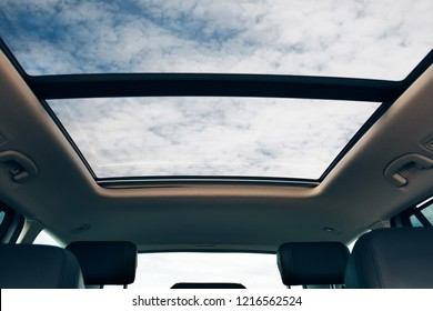 Panoramic sun roof at the car and blue sky
