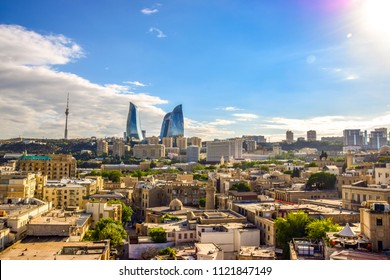 Panoramic sunny summer view of Baku, capital city of Azerbaijan. The Old Town in the foreground, and the modern Flame Towers in background.