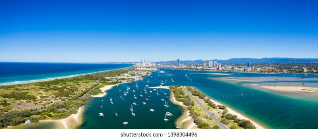 Panoramic sunny view of boats around the Spit and the Gold Coast seaway, QLD, Australia