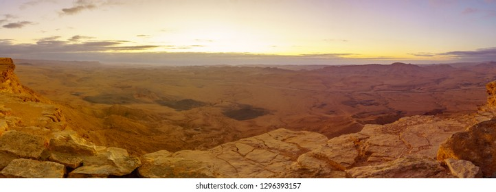 Panoramic sunrise view of Makhtesh (crater) Ramon, in the Negev Desert, Southern Israel. It is a geological landform of a large erosion cirque