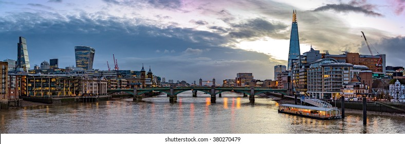 Panoramic, sunrise view of the river Thames and the city of London, east of Millennium Bridge.