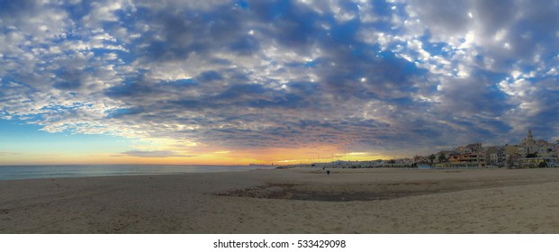 Panoramic sunset with clouds on the beach. Atmospheric phenomena concept