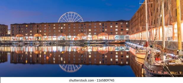 Panoramic Sunset dusk at UNESCO world heritage site the Royal Albert Dock Liverpool at Pier head in Liverpool England UK.