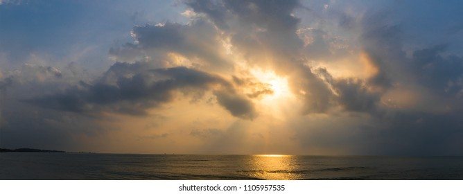 Panoramic sunset with fluffy clouds in the twilight sky,Sunlight with dramatic cloud over sea