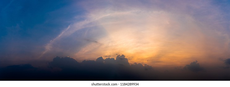 Panoramic sunset with fluffy clouds in the twilight sky,Sunlight with dramatic cloud