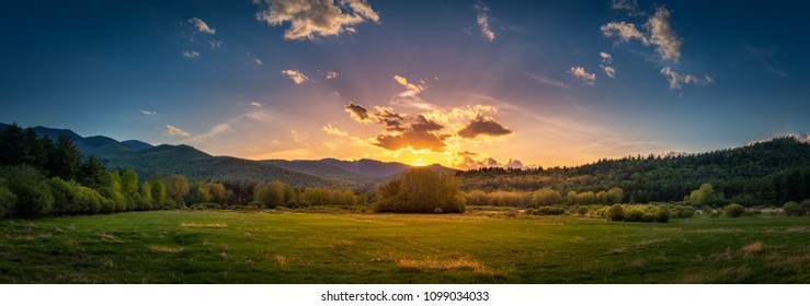 Panoramic sunset on the High Peaks Region in the Adirondacks as seen from Keene, NY