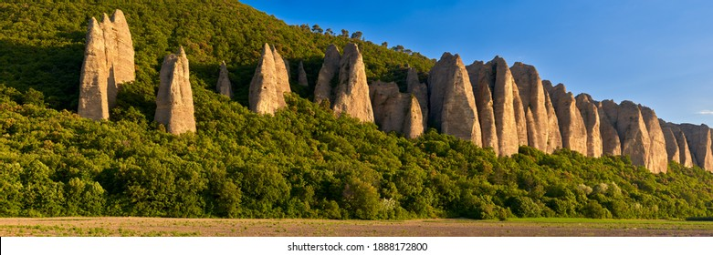 "Panoramic sunset on monolith rock formation called ""Les Pénitents"" near the village of Les Mées. Provence-Alpes-Cote d'Azur (PACA Region), France - Shutterstock ID 1888172800"