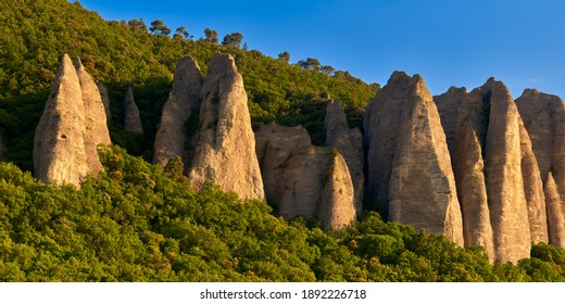 "Panoramic sunset on monolith rock formation called ""Les Pénitents"" near the village of Les Mées. Provence-Alpes-Cote d'Azur (PACA Region), France - Shutterstock ID 1892226718"