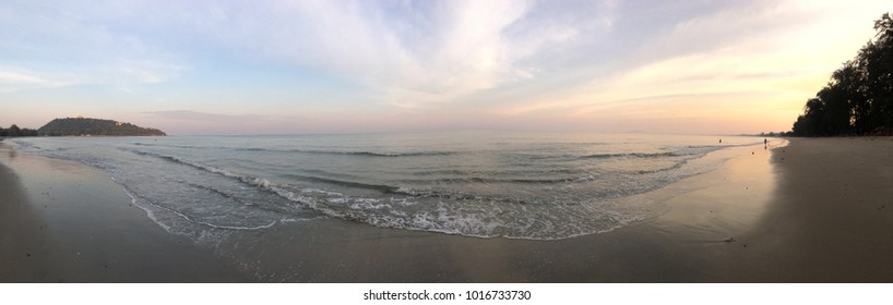 Panoramic Sunset Seaview-sky,beach,hills and shoreline.