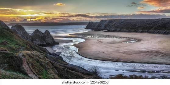 Panoramic sunset at Three Cliffs Bay, Gower, Swansea, UK