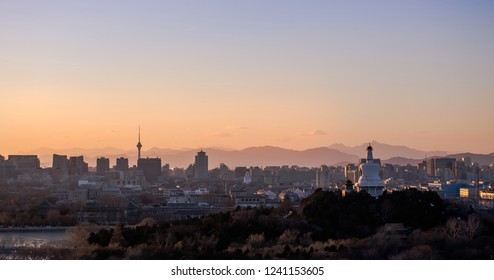 Panoramic sunset view of Beijing Skyline, as seen from Jingshan park (Coal hill).