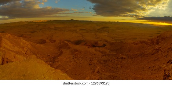 Panoramic sunset view of Makhtesh (crater) Ramon, in the Negev Desert, Southern Israel. It is a geological landform of a large erosion cirque