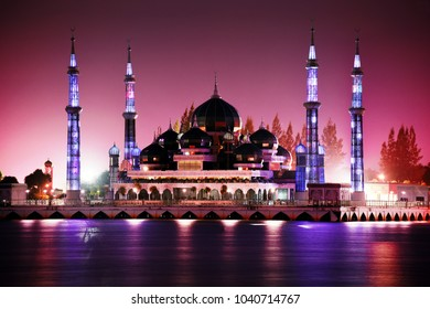 panoramic sunset view of Masjid Kristal (Crystal mosque) in Kuala Terengganu, Malaysia with red sky