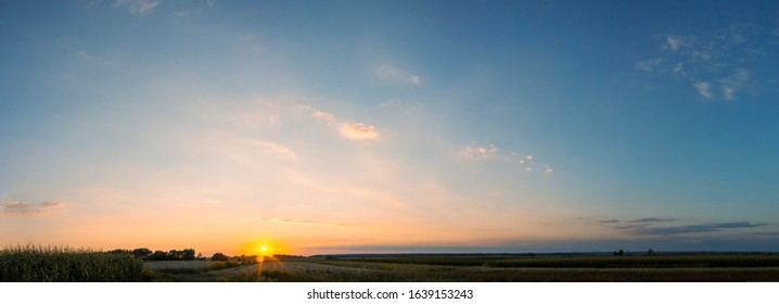 panoramic sunset view over fields in summer - Shutterstock ID 1639153243