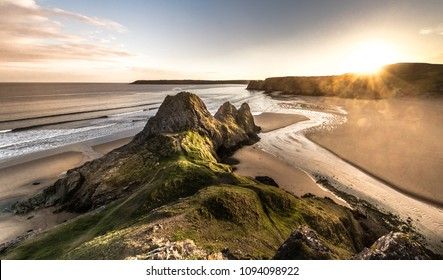 Panoramic of suntset at Three Cliffs in the Gower Peninsula, South Wales, UK. Taken May 2018