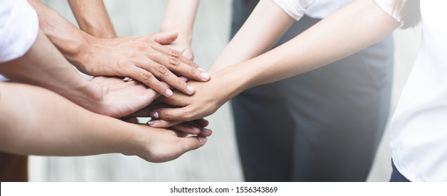 Panoramic teamwork business join hand together concept, Business team standing hands together, Volunteer charity work. People joining for cooperation success business.