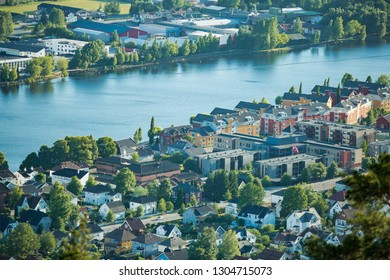 Panoramic top view of Drammen city, mountains in fog and valley with river, sunny weather. Norway