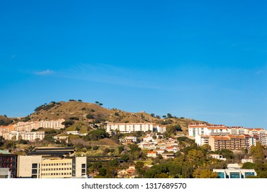 Panoramic top view of the local buildings among the mountains in the beautiful Italian city Messina in front of Reggio Calabria, Sicily, Italy. Europe. Mediterranean sea.