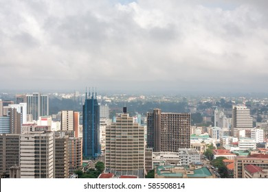 Panoramic top view on central business district of Nairobi from helipad on the roof of Kenyatta International Conference Centre (KICC) building at overcast day. Kenya.