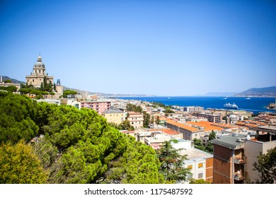 Panoramic top view of the strait and coasts of Messina with Sacrario di Cristo Re and Calabria, Sicily, Italy