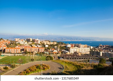Panoramic top view of the strait and coasts of the beautiful Italian city Messina and Reggio Calabria, Sicily, Italy. Europe. Mediterranean sea. Local buildings.