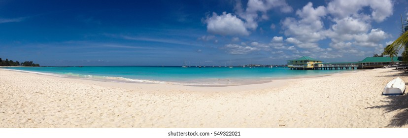 Panoramic tropical beach with white sand and turquoise sea