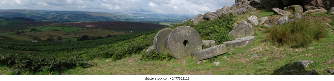 A panoramic view of the abandoned millstones on Stanage Edge in The Peak District National Park England.
