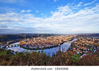 Panoramic view from above to Cahors town (France) surrounded by Lot river and hills