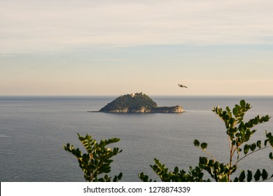 Panoramic view from above of the Gallinara Island, the shelter of St Martin of Tours and site of a monastery up to 1842; currently the isle is privately owned. Alassio, Liguria, Italy